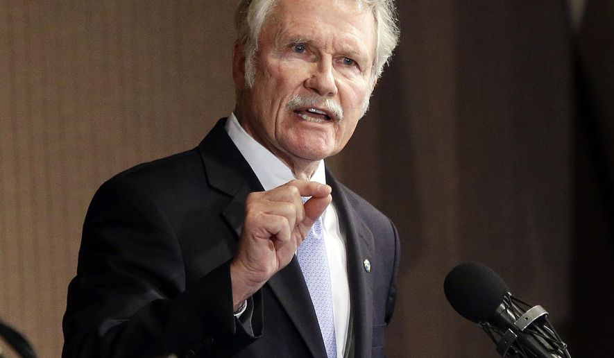 FILE - In this Oct. 10, 2014, file photo, Oregon Gov. John Kitzhaber speaks during a gubernatorial debate in Portland, Ore. Kitzhaber said he planned to resign amid allegations his fiancee used her relationship with him to enrich herself - a stunning fall from grace for the state's longest-serving chief executive, a person with direct knowledge of the situation said on Friday, Feb. 13, 2015. (AP Photo/Don Ryan, File)