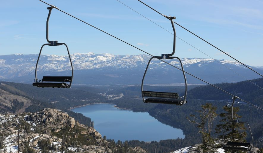 In this photo taken Wednesday, Jan. 28, 2015, chairs on a ski lift overlooking Donner Lake, sit idle at Donner Ski Ranch in Norden, Calif.  Midway through California's ski season, the ranch is one of several ski resorts that have either suspended operations or cut back on the number of lifts operating due to the state's historic drought. (AP Photo/Rich Pedroncelli)