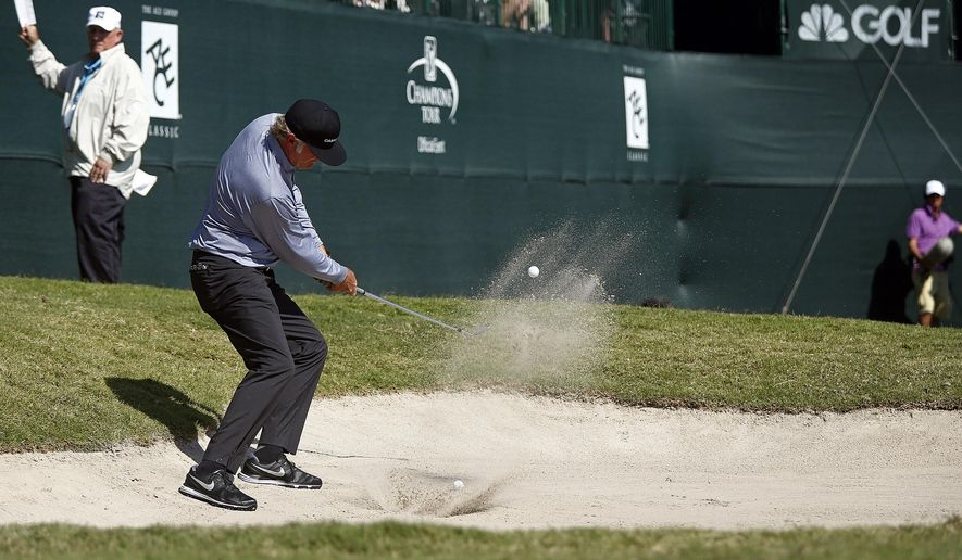 Tommy Armour III hits out of sand trap on the 18th hole during the first round of the Champions Tour golf tournament at TwinEagles Club Friday, Feb. 13, 2015, in Naples, Fla. (AP Photo/Naples Daily News, Corey Perrine)  FORT MYERS OUT TV OUT, MAGS OUT