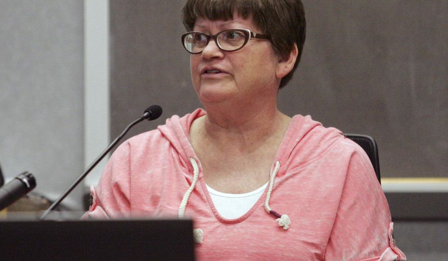 Allison Simmons testifies Friday, Feb. 13, 2015 in Black Hawk County District Court in Waterloo, Iowa. Theresa Supino was arrested in March in connection with the 1983 killings of Steven Fisher and Melisa Gregory, whose bodies were found on the ranch. (AP Photo/The Courier, Dennis Magee)