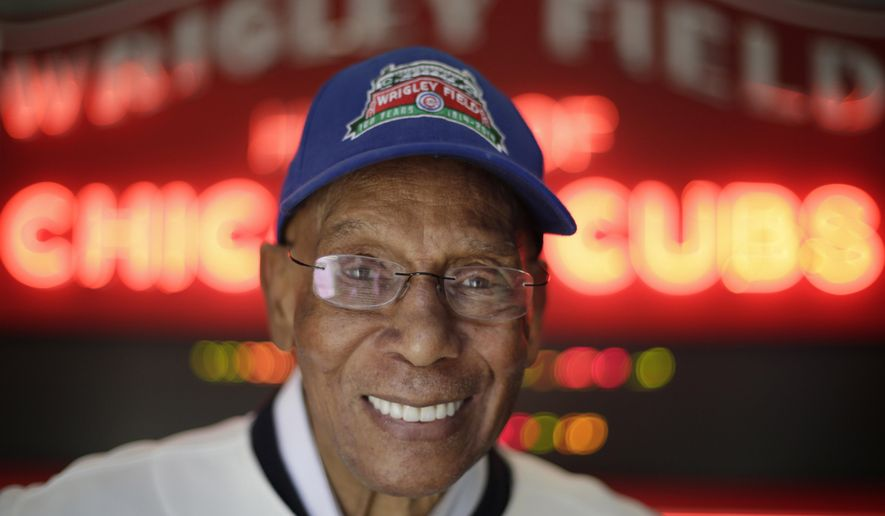 FILE - In this March 24, 2014 file photo, Chicago Cubs Hall of Fame slugger Ernie Banks smiles after an interview at the Cubs offices in Chicago. Banks died Jan. 23, 2015. Banks, who once said he wanted to have his ashes scattered at Wrigley Field, is at the center of a battle over his remains, with his estranged wife trying to prevent a longtime friend of Banks from having his remains cremated. (AP Photo/M. Spencer Green, File)