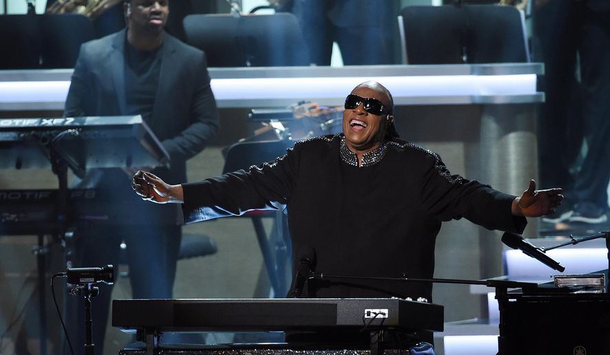 "FILE-- In this Tuesday, Feb. 10, 2015 file photo, Stevie Wonder takes in applause from the stage during the finale of ""Stevie Wonder: Songs in the Key of Life - An All-Star Grammy Salute,"" at the Nokia Theatre L.A. Live in Los Angeles.  The show will air 9-11 p.m. EST Monday, Feb. 16, 2015, on CBS. (Photo by Chris Pizzello/Invision/AP, File)"