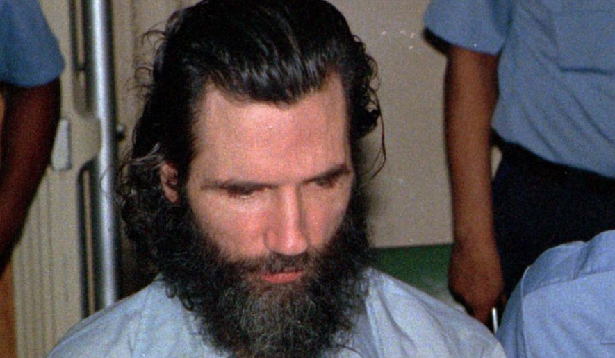 "FILE--In this file photo from June 29, 1988 murder-kidnap-rape suspect Gary Heidnik, is escorted from a holding cell. Heidnik, executed by lethal injection on July 6, 1999, was the last person to have the death penalty enforced upon in Pennsylvania. Newly elected Pennsylvania Gov. Tom Wolf imposed a moratorium on the death penalty in the state on Friday Feb. 13, 2015, calling the current system of capital punishment ""error-prone, expensive and anything but infallible."" (AP Photo/George Widman,FILE)"