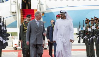 In this Feb. 12, 2015, photo provided by Crown Prince Court - Abu Dhabi, Sheikh Mohamed bin Zayed Al Nahyan, Crown Prince of Abu Dhabi and Deputy Supreme Commander of the Armed Forces of the United Arab Emirates (UAE), center right, receives Prince Charles at the Presidential Airport in Abu Dhabi, UAE. (AP Photo/Ryan Carter, Crown Prince Court - Abu Dhabi)