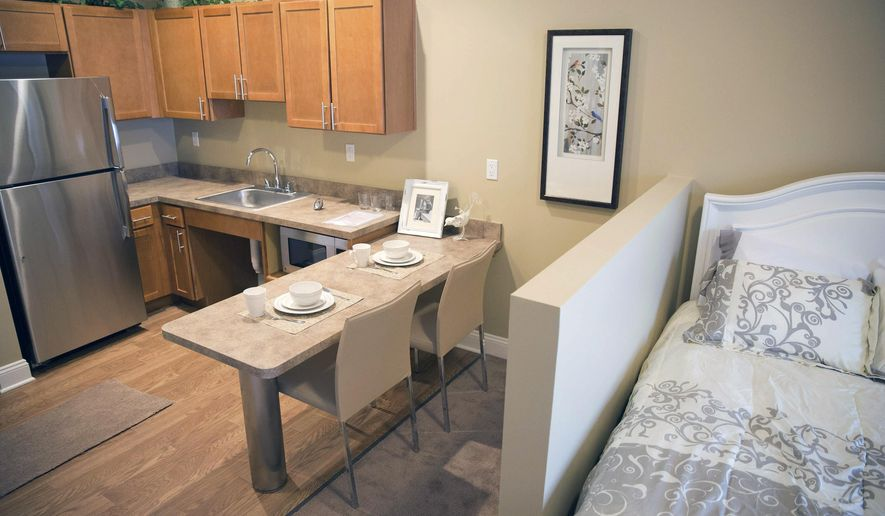 In this Feb. 4, 2015 photo, a studio assisted living apartment comes equipped with a kitchenette and a partial wall to obscure the bed at The Heritage at Sterling Ridge in Omaha, Neb. Heritage Communities is putting the finishing touches on a $14 million retirement center near 132nd and Pacific Streets that will allow residents to transition to a higher level of care without a change of scenery.(AP Photo/The World-Herald, Rebecca S. Gratz) MAGS OUT; ALL NEBRASKA LOCAL BROADCAST TELEVISION OUT