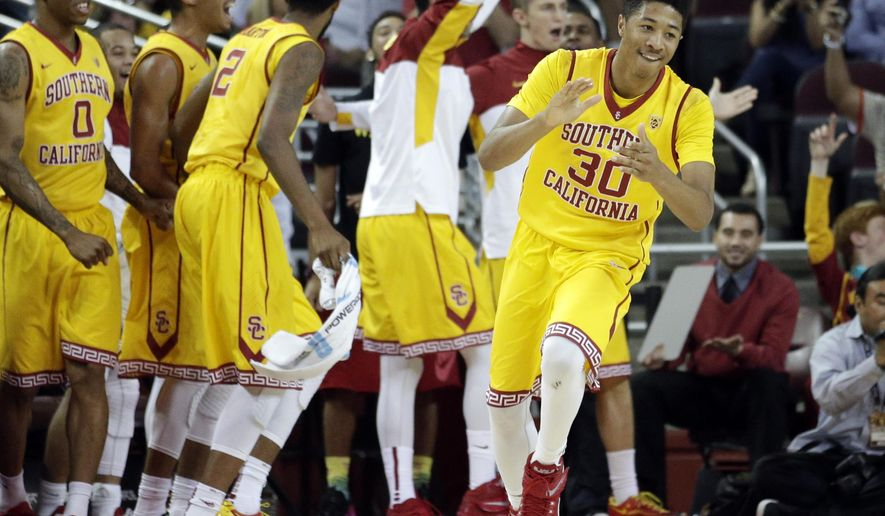 Southern California's Elijah Stewart(30) celebrates a basket by Julian Jacobs during the second half of an NCAA college basketball game against Oregon State, Saturday, Feb. 14, 2015, in Los Angeles. USC won 68-55. (AP Photo/Jae C. Hong)