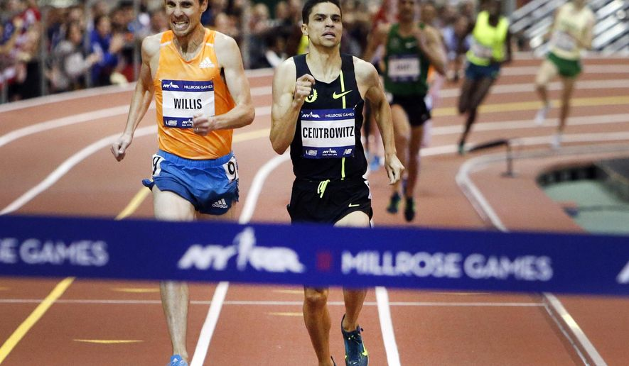Matthew Centrowitz, right, races down the final stretch ahead of Nick Willis in the men's Wanamaker Mile during the Millrose Games, Saturday, Feb. 14, 2015, in New York. Centrowitz won the race with a time of 3:51.35. (AP Photo/Jason DeCrow)