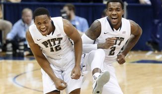 Pittsburgh's Chris Jones (12) and Michael Young (2) celebrate after Jones hit a 3-point shot in the first half of an NCAA college basketball game against North Carolina, Saturday, Feb. 14, 2015, in Pittsburgh. Pittsburgh upsetNo. 12 North Carolina 89-76. (AP Photo/Keith Srakocic)