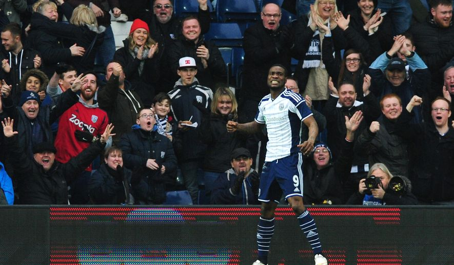 West Brom's Brown Ideye celebrates with fans after scoring his second goal, West Brom's third against West Ham's during the FA Cup fifth round soccer match between West Bromwich Albion and West Ham United, at the Hawthorns, West Bromwich, England, Saturday, Feb. 14, 2015. (AP Photo/Rui Vieira)