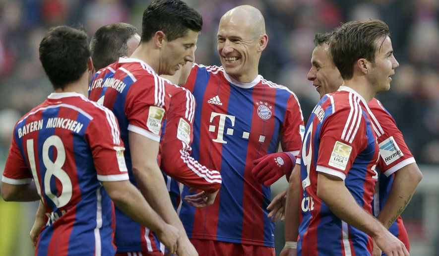 Bayern's Arjen Robben from the Netherlands, center, celebrates with team mates after Franck Ribery from France scored his side's 7th goal during the German first division Bundesliga soccer match between FC Bayern Munich and Hamburger SV in the Allianz Arena in Munich, Germany, Saturday, Feb. 14, 2015. (AP Photo/Matthias Schrader)