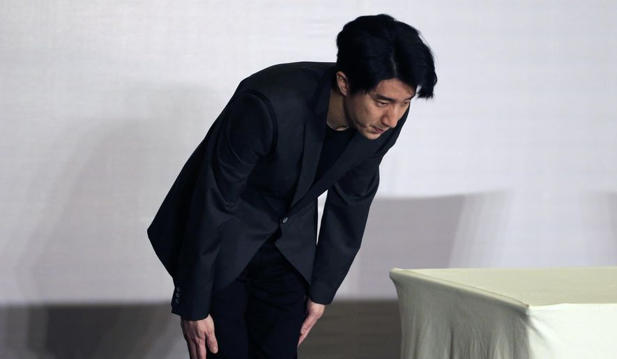 Hong Kong actor Jaycee Chan bows after a news conference at a hotel in Beijing Saturday, Feb. 14, 2015. Chan, son of actor Jackie Chan has apologized and asked for a second chance following his release from a six-month jail sentence for allowing people to use marijuana in his apartment. (AP Photo/Andy Wong)