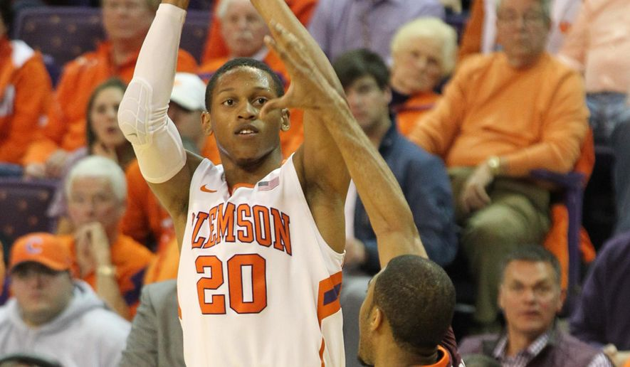 Clemson's Jordan Roper, left, shoots over Virginia Tech's Adam Smith during an NCAA college basketball game , Saturday, Feb. 14, 2015 in Clemson, S.C. (AP Photo/Anderson Independent-Mail, Mark Crammer)