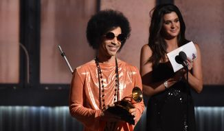 In this Feb. 8, 2015, file photo, Prince presents the award for album of the year at the 57th annual Grammy Awards in Los Angeles. (Photo by John Shearer/Invision/AP)