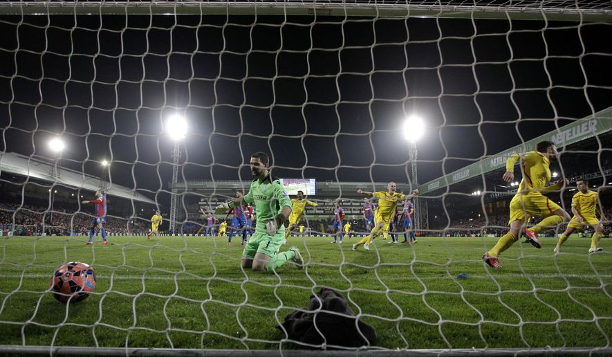 Liverpool's Adam Lallana, second right, celebrates scoring his side's second goal with Martin Skrtel, third right, during the English FA Cup fifth round soccer match between Crystal Palace and Liverpool at Selhurst Park stadium in London, Saturday, Feb. 14, 2015.  (AP Photo/Matt Dunham)