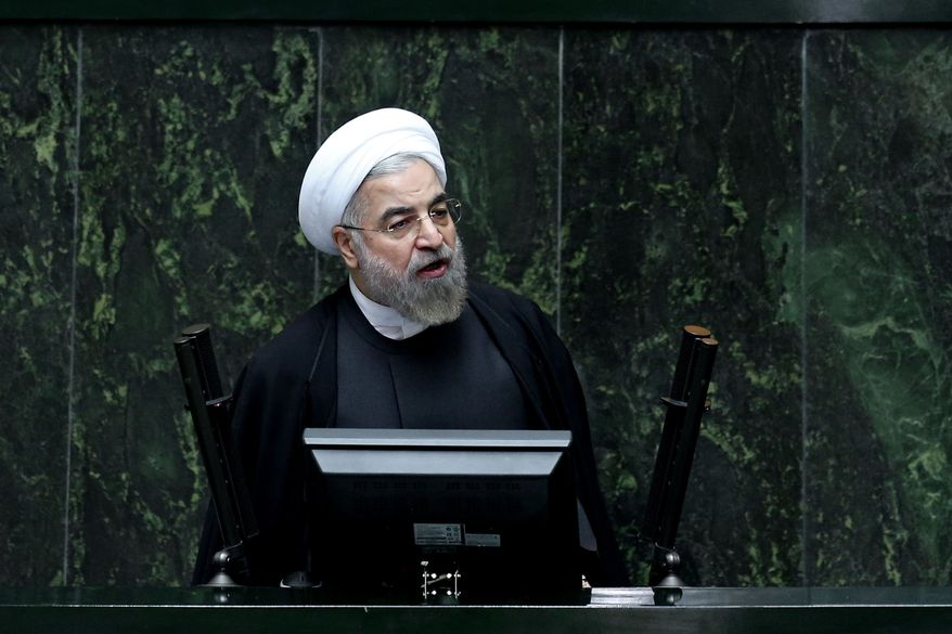 In this file photo taken on Wednesday, Oct. 29, 2014, Iranian President Hassan Rouhani speaks during a debate on a vote of confidence for his choice for the new minister of Science, Research and Technology, Mahmoud Nili Ahmadabadi, in an open session of parliament in Tehran, Iran. (AP Photo/Ebrahim Noroozi, File)