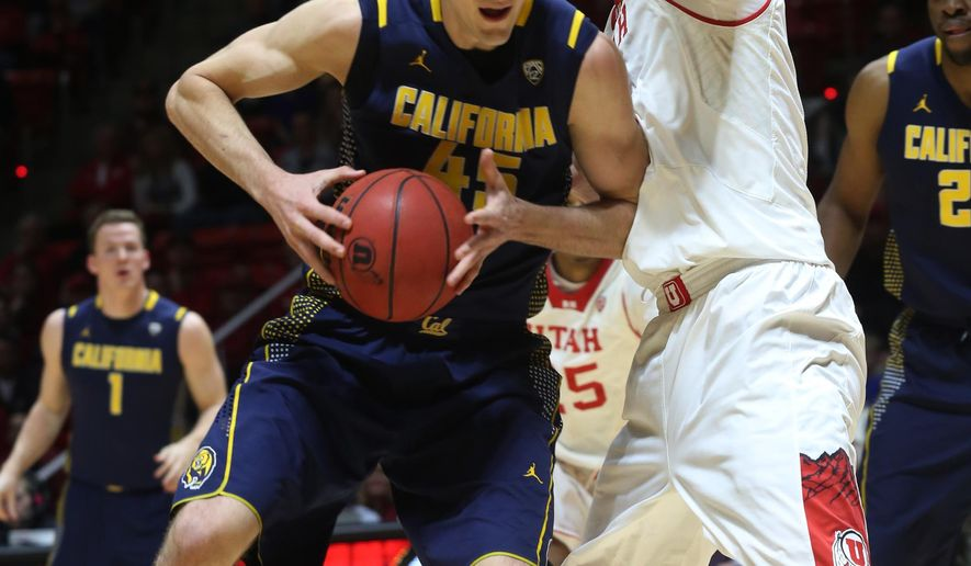 California forward David Kravish, left, tries to hang onto the ball as he is defended by Utah center Dallin Bachynski, right, in the first half during an NCAA college basketball game on Sunday, Feb. 15, 2015, in Salt Lake City. (AP Photo/Kim Raff)