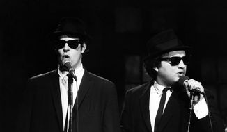 "This Nov. 18, 1978, file photo released by NBC shows Dan Aykroyd as Elwood Blues, left, and John Belushi as Jake Blues, performing as the Blues Brothers on ""Saturday Night Live"" in New York. The long-running sketch comedy series celebrated its 40th anniversary with a 3-hour special airing Sunday on NBC. (AP Photo/NBC, Al Levine)"