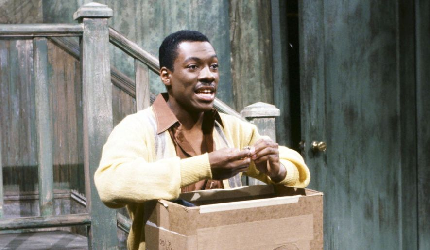"""In this May 13, 1983 photo released by NBC shows Eddie Murphy as Mr. Robinson during the """"Mister Robinson's Neighborhood"""" sketch on """"Saturday Night Live,"""" in New York. The long-running sketch comedy series will celebrate their 40th anniversary with a 3-hour special airing Sunday at 8 p.m. EST on NBC. (AP Photo/NBC, Al Levine)"""
