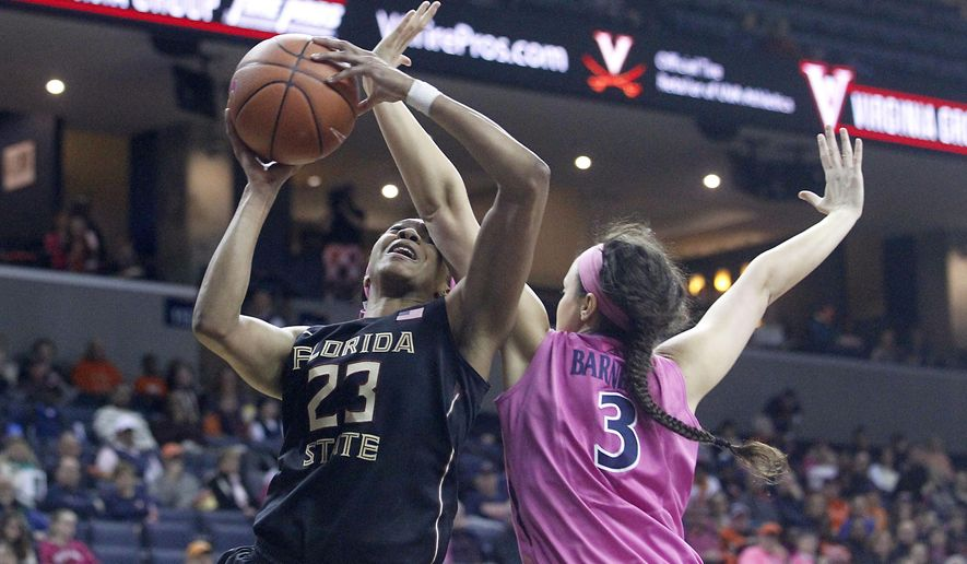 Florida State forward Ivey Slaughter (23) draws a foul from Virginia forward Sarah Beth Barnette (3) during the first half of an NCAA college basketball game in Charlottesville, Va., Sunday, Feb. 15, 2015. (AP Photo/Ryan M. Kelly)