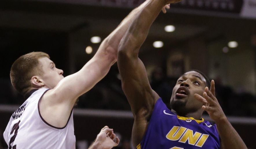 Northern Iowa forward Marvin Singleton (12) shoots while covered by Missouri State guard Austin Ruder (2) during the first half of an NCAA basketball game in Springfield, Mo., Sunday, Feb. 15, 2015. (AP Photo/Orlin Wagner)