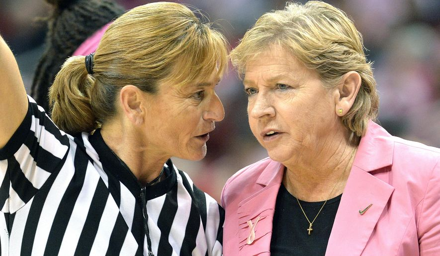 North Carolina head coach Sylvia Hatchell, right, discusses a call with game official Dee Kantner during the first half of an NCAA college basketball game against Louisville, Sunday, Feb. 15, 2015, in Louisville, Ky. (AP Photo/Timothy D. Easley)