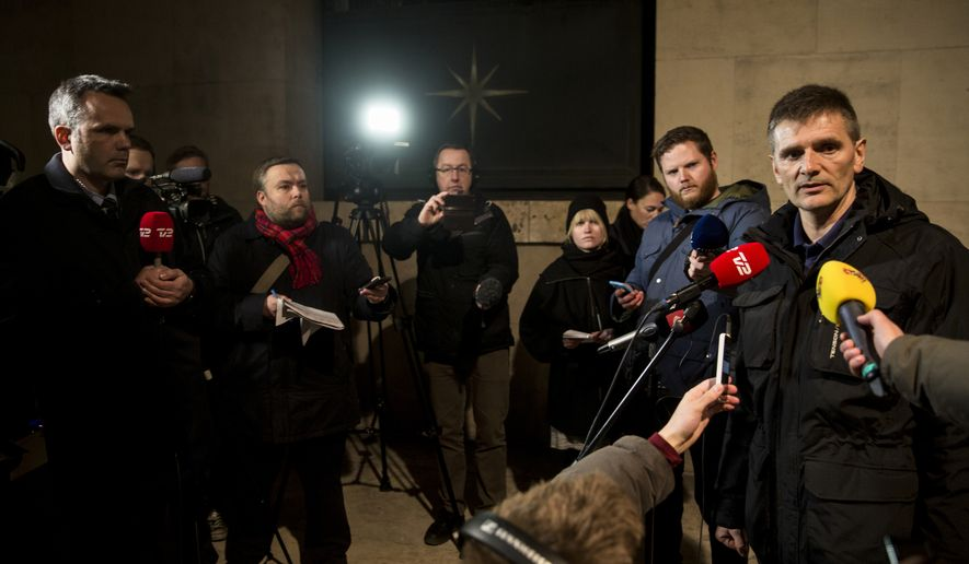 """Police spokesman Joergen Skov, right, talks during a press conference at police headquarters after shots were fired where an event titled """"Art, blasphemy and the freedom of expression"""" was being held in Copenhagen, Saturday, Feb. 14, 2015. Shots were fired Saturday at a cafe in Copenhagen that was hosting a freedom of speech event organized by Swedish artist Lars Vilks, who has faced numerous threats for caricaturing the Prophet Muhammad. (AP Photo/Polfoto, Janus Engel)"""