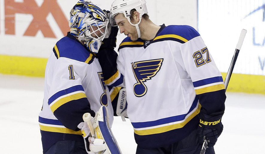 St. Louis Blues defenseman Alex Pietrangelo (27) congratulates St. Louis Blues goalie Brian Elliott (1) after a 2-1 win against the Florida Panthers in a shootout of an NHL hockey game in Sunrise, Fla., Sunday, Feb. 15, 2015. (AP Photo/Alan Diaz)