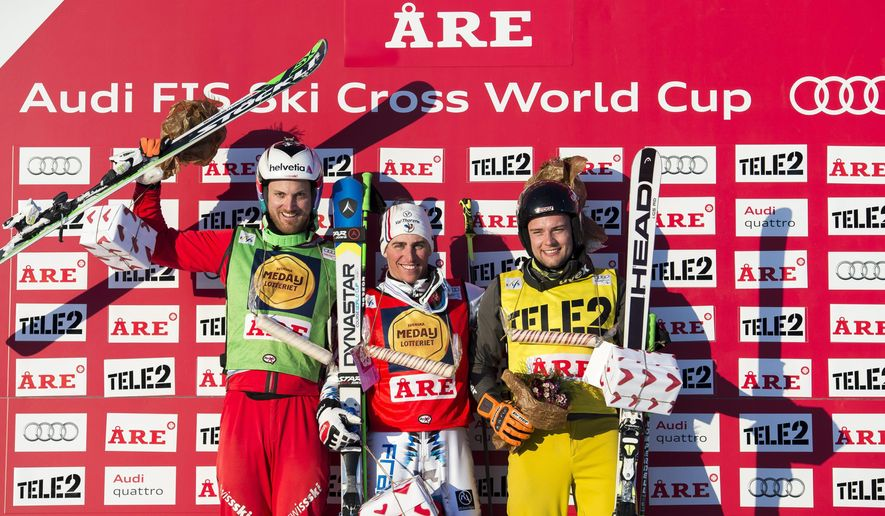 Winners on the podium, with from left, Alex Fiva of Switzerland second place, Jean Frederic Chapuis of France first place and Paul Eckert of Germany third place, as they pose after the men's Ski Cross final at the Freestyle Skiing World Cup in Are, Sweden, Feb. 15, 2015. (AP Photo/Marcus Ericsson)  SWEDEN OUT