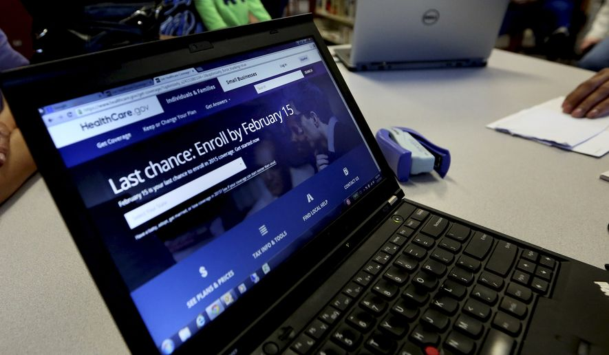 In this Thursday, Feb. 12, 2015 photo, a laptop shows the HealthCare.com web site during an Affordable Care Act enrollment event at the Fort Worth Public Library in Fort Worth, Texas. (Associated Press) ** FILE **