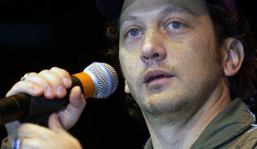 "Comedian Rob Schneider performs for Aviano Air Base spectators at the USO Holiday Tour 2001 show. California State Assemblywoman Lorena Gonzalez says she received a ""disturbing message"" Wednesday from Schneider, who allegedly threatened to fight her political efforts to mandate vaccinations for children. (Wikipedia)"