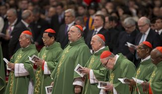 Newly elected cardinals attend a Mass celebrated by Pope Francis, in St. Peter's Basilica at the Vatican, Sunday, Feb. 15, 2015. Pope Francis welcomed 20 new cardinals Saturday into the elite club of churchmen who will elect his successor and immediately delivered a tough-love message to them, telling them to put aside their pride, jealousy and self-interests and instead exercise perfect charity. (AP Photo/Andrew Medichini)