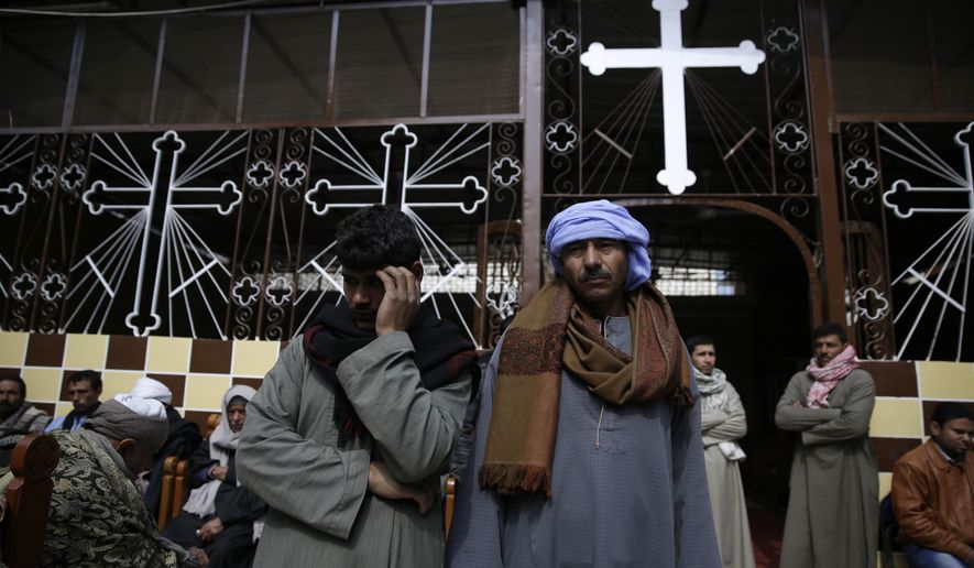 Men mourn over the Egyptian Coptic Christians who were captured in Libya and killed by militants affiliated with the Islamic State group, at the Virgin Mary church in the village of el-Aour, near Minya, 220 kilometers (135 miles) south of Cairo, Egypt, Monday, Feb. 16, 2015. (Associated Press) ** FILE **
