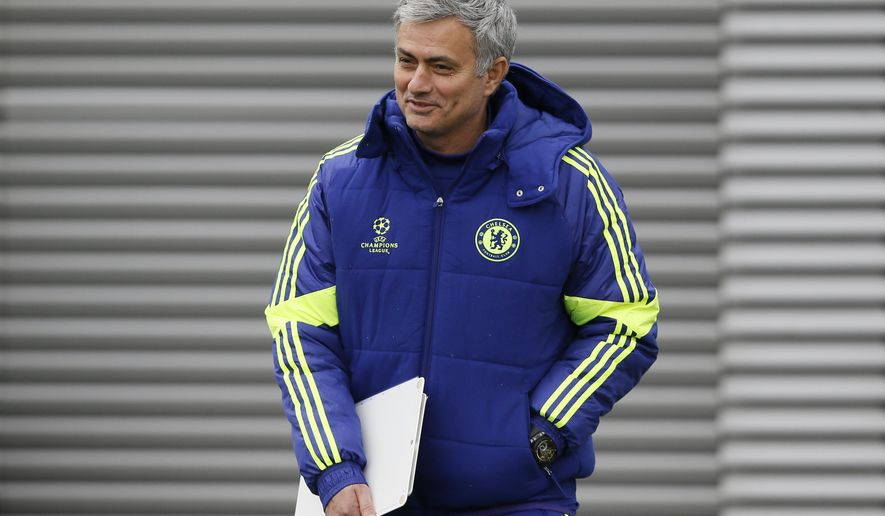 Chelsea's manager Jose Mourinho smiles as he arrives for a training session at the training ground in Cobham, England, Monday, Feb. 16, 2014. Chelsea will play Paris Saint Germain in a Champions League knock out round of sixteen in Paris on Tuesday. (AP Photo/Kirsty Wigglesworth)