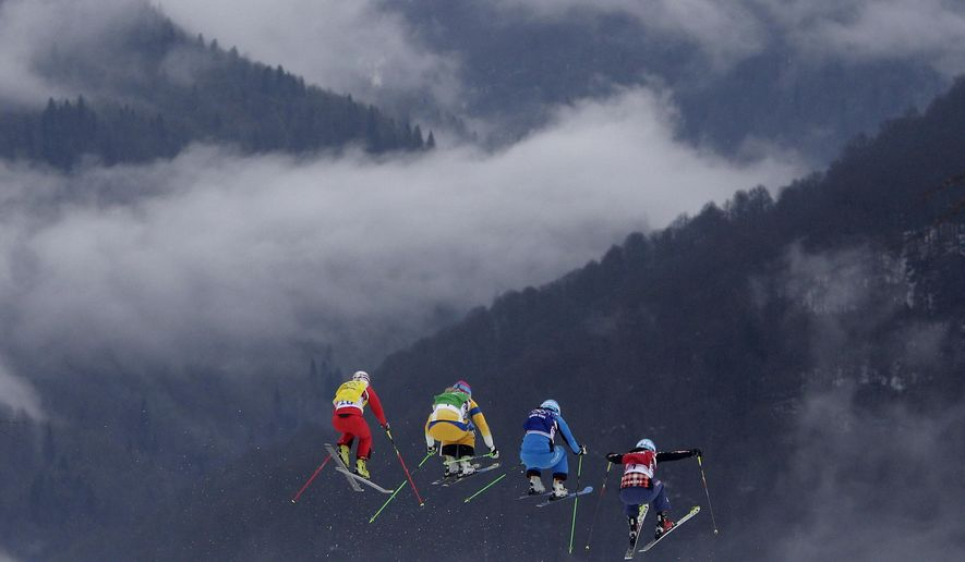 FILE - In this Feb. 21, 2014 file photo, Switzerland's Fanny Smith, from left, Sweden's Anna Holmlund, Austria's Katrin Ofner and Canada's Kelsey Serwa compete during their ski cross race at the 2014 Winter Olympics in Krasnaya Polyana, Russia. The photo was honored by the Associated Press Sports Editors as best sports action photo of 2014 at their annual winter meeting in Orlando, Fla. (AP Photo/Matthias Schrader, File)