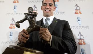 Marcus Mariota holds the Davey O'Brien award during a news conference on Monday, Feb. 16, 2015, in Fort Worth, Texas. Mariota was in North Texas on Monday night to receive the Davey O'Brien Award that goes to the nation's top quarterback. (AP Photo/The Fort Worth Star-Telegram, Joyce Marshall)  MAGS OUT; (FORT WORTH WEEKLY, 360 WEST); INTERNET OUT
