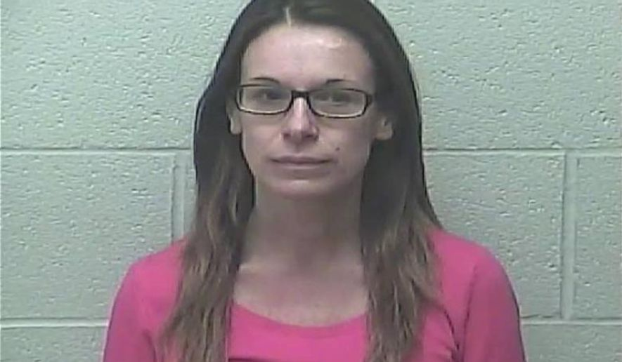 This undated photo provided by the  Burleigh County Detention Center shows North Dakota Superintendent of Public Instruction Kirsten Baesler. A statement from the Bismarck Police Department said Baesler was taken into custody after officers responded to a home early Sunday, Feb. 15, 2015, due to a report of a domestic assault. (AP Photo/Burleigh County Detention Center)