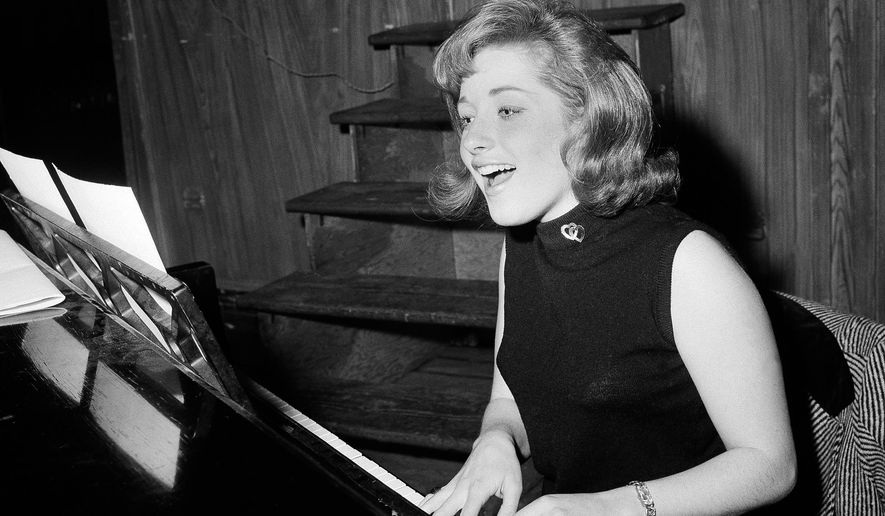 """FILE - In this Jan. 5, 1966, file photo, singer Lesley Gore rehearses at a piano, in New York. Singer-songwriter Gore, who topped the charts in 1963 with her epic song of teenage angst, """"It's My Party,"""" and followed it up with the hits """"Judy's Turn to Cry,"""" and """"You Don't Own Me,"""" died of cancer, Monday, Feb. 16, 2015. She was 68.  (AP Photo/Dan Grossi, File)"""