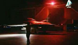 In this image made from video broadcast on Egyptian state television on Monday, Feb. 16, 2015, a fighter jet leaves the hangar in preparation to launch airstrikes against Islamic State targets in Libya after the extremist group released a grisly video showing the beheading of several Egyptian Coptic Christians it had held hostage for weeks. (AP Photo/Egyptian State Television via AP video)