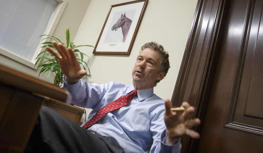 """In this photo taken Feb. 10, 2015, Sen. Rand Paul, R-Ky. takes questions during an interview with The Associated Press in his office on Capitol Hill in Washington. Paul is having an easier time finding success inside the cloistered, tradition-bound Senate than on the unpredictable presidential campaign trail. There, it's a hard-to-control world where Paul's every error _ even a televised, """"shush"""" _ ricochets around the internet and gets in the way of the story he's trying to tell.  (AP Photo/J. Scott Applewhite)"""