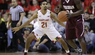 Maryland guard Varun Ram (21) guards Fordham guard Bryan Smith during an NCAA college basketball game, Thursday, Nov. 20, 2014, in College Park, Md. (AP Photo/Patrick Semansky)