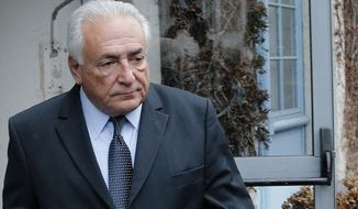 Former International Monetary Fund boss Dominique Strauss-Kahn leaves his hotel in Lille, northern France, Wednesday, Feb. 11, 2015, as he goes on trial for sex charges at a court. Strauss-Kahn sat nonchalantly with folded-arms and stretched legs Tuesday, before telling a French court he was completely unaware that women who participated in orgies at luxury hotels in Paris and Washington were prostitutes. (AP Photo/Christophe Ena)