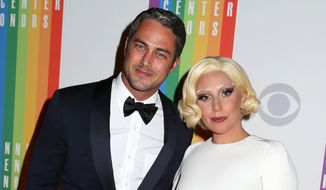 Taylor Kinney and Lady Gaga attend the 37th Annual Kennedy Center Honors in Washington. (Associated Press)