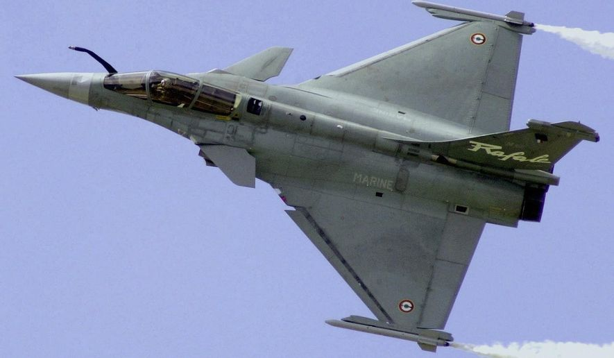 FILE - In this June 21, 2001 file photo, a French Air Force Rafale manufactured by France's Dassault Aviation speeds above Le Bourget airport, north of Paris, France, during the 44th Paris Air Show. Egypt will become the first foreign buyer of Rafale fighter jets, French officials said Thursday, purchasing 24 of the multi-role French-made aircraft as part of a 5.2 billion-euro (US$5.93 billion) defense deal that will strengthen Cairo's military might in a tense and violent region. (AP Photo/Remy de la Mauviniere, File)