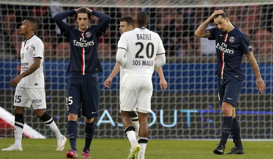 Paris St Germain's Zlatan Ibrahimovic, right, and Paris St Germain's Adrien Rabiot, second left,  react, at the end of the French league one soccer match between PSG and Caen, in Paris, France, Saturday, Feb. 14, 2015. The match ended in a draw 2-2.  (AP Photo/Christophe Ena)