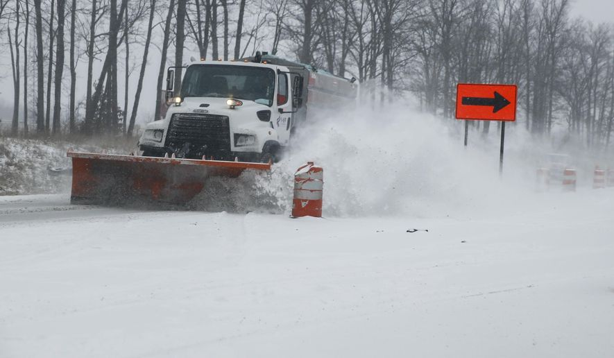 An I-69 snow plow clears Ind. 37 just north of where it crosses over the I-69 interstate construction site, Monday, Feb. 16, 2015 in Bloomington, Ind. Counties across southern Indiana are warning motorist of treacherous travel conditions following several inches of snowfall. (AP Photo/Bloomington Herald-Times, Jeremy Hogan)