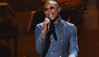 "Pharrell Williams performs at ""Stevie Wonder: Songs in the Key of Life - An All-Star Grammy Salute,"" at the Nokia Theatre L.A. Live on Tuesday, Feb. 10, 2015, in Los Angeles. (Photo by Chris Pizzello/Invision/AP)"