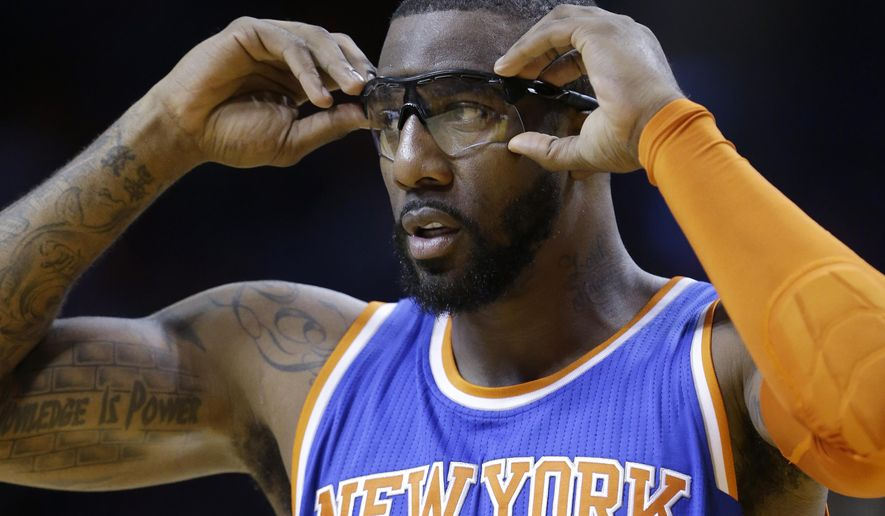 FILE - In this Feb. 9, 2015, file photo, New York Knicks center Amar'e Stoudemire adjusts his glasses during the first half of an NBA basketball game against the Miami Heat in Miami. The Mavericks are tinkering again, this time preparing to add Amare Stoudemire after the last-place Knicks let him out of his contract. (AP Photo/Wilfredo Lee, File)