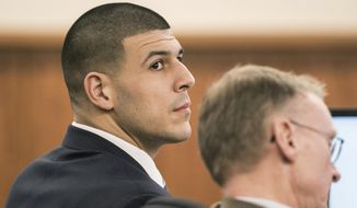 Aaron Hernandez sits with his attorney Charles Rankin during the former New England Patriots football player's murder trial, Friday, Feb. 13, 2015, in Fall River, Mass. Hernandez is charged with killing semiprofessional football player Odin Lloyd. (AP Photo/The Boston Globe, Aram Boghosian, Pool)