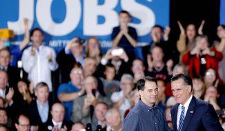 "Scott Walker has inherited the ""Romney vote,"" says one pollster. (Associated Press)"