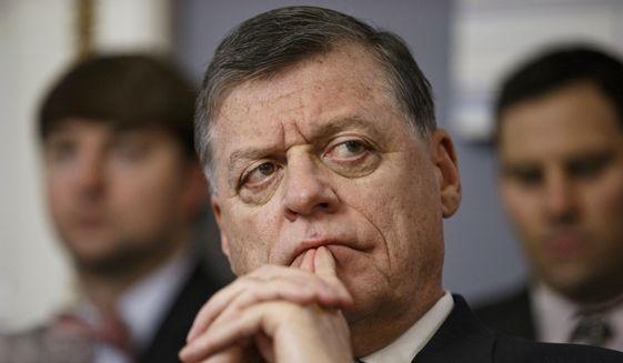 Rep. Tom Cole, R-Okla., listens on Capitol Hill in Washington in this Jan. 7, 2015, file photo. (AP Photo/J. Scott Applewhite, File)